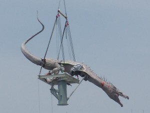 The dragon being hoisted on top of Gringotts Bank last week - Picture Credits @ Amusement Buzz