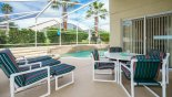 Wynnewood 10 Villa rental near Disney with View of pool from covered lanai with patio table & 4 chairs & 6 sun loungers