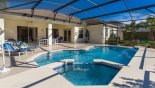 Spacious rental Highlands Reserve Villa in Orlando complete with stunning View of pool towards shady lanai with patio table & 6 chairs