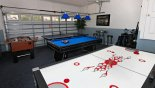 Games room with pool table, air hockey, table tennis & table foosball from Highlands Reserve rental Villa direct from owner
