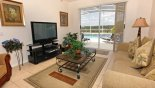 Living room with direct access and great views onto pool deck with this Orlando Villa for rent direct from owner