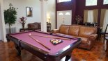 Watch a game of pool relaxing after dinner - www.iwantavilla.com is the best in Orlando vacation Villa rentals