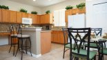 Fully equipped kitchen with granite counter tops and mosaic back splash & breakfast nook from Highlands Reserve rental Villa direct from owner