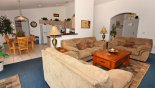 Family room viewed towards entrance foyer & kitchen from Madison + 2 Villa for rent in Orlando
