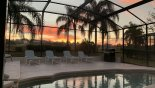 Wonderful sunrise over pool deck if you are up early enough - www.iwantavilla.com is your first choice of Villa rentals in Orlando direct with owner