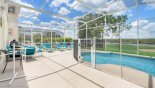 Extended section of pool deck gets the sun all day - www.iwantavilla.com is the best in Orlando vacation Villa rentals