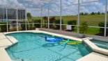 Sunny pool & spa with golf course views - www.iwantavilla.com is your first choice of Villa rentals in Orlando direct with owner