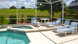 Pool deck with 4 sun loungers - www.iwantavilla.com is the best in Orlando vacation Villa rentals