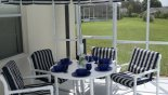 Patio table with parasol and 6 chairs (2 of which are reclining) - www.iwantavilla.com is the best in Orlando vacation Villa rentals