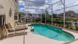 Spacious rental Highlands Reserve Villa in Orlando complete with stunning Sunny south facing pool deck and 4 sun loungers