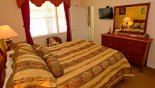 Master bedroom 1 with wall mounted flat screen TV from Silver Maple + 1 Villa for rent in Orlando