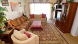 Family room with direct access onto pool deck from Silver Maple + 1 Villa for rent in Orlando