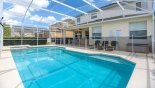 Pool deck showing pool safety fence ereced with this Orlando Villa for rent direct from owner
