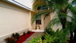 Spacious rental Highlands Reserve Villa in Orlando complete with stunning ENTRANCE LANDSCAPING