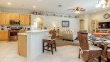 Kitchen & family room - www.iwantavilla.com is the best in Orlando vacation Villa rentals
