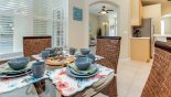 Breakfast nook off kitchen with views onto pool deck from Cambridge 11 Villa for rent in Orlando
