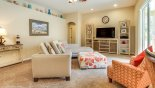 Family room with large flat screen TV - www.iwantavilla.com is the best in Orlando vacation Villa rentals