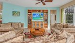Villa rentals in Orlando, check out the Family room with large wall mounted LCD cable TV, DVD player & selection of DVD's
