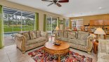 Family room with ample seating to watch a movie on the large LCD cable TV - www.iwantavilla.com is the best in Orlando vacation Villa rentals