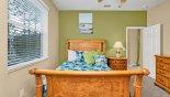 Ground floor bedroom #5 with queen sized sleigh bed - www.iwantavilla.com is the best in Orlando vacation Villa rentals