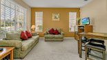 Villa rentals near Disney direct with owner, check out the Front living room with comfortable seating and card playing / gaming table