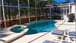 Pool & spa showing other 2 sun loungers with foot stools from Highlands Reserve rental Villa direct from owner