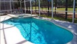 View of pool & spa with golf course view beyond from Mayfield 2 Villa for rent in Orlando