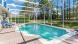 Villa rentals near Disney direct with owner, check out the Large pool deck and pool with views through trees to golf course