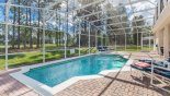 Spacious rental Highlands Reserve Villa in Orlando complete with stunning Large sunny pool deck with 4 sun loungers