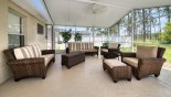 Comfortable outdoor living space under covered lanai with this Orlando Villa for rent direct from owner