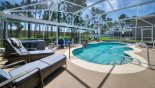 Orlando Villa for rent direct from owner, check out the Pool deck with pine tree backdrop