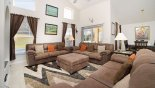Family room with views and direct access onto pool deck from Sandlewood + 1 Villa for rent in Orlando