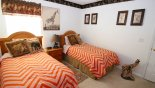 Twin bedroom 3 with LCD cable TV (just out of view) with this Orlando Villa for rent direct from owner