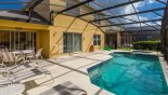 Villa rentals in Orlando, check out the Covered lanai with patio table & 4 chairs