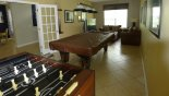 Games room with pool table, table foosball & large TV / PS3 & 2 comfortable sofas from Charlotte Harbor 1 Villa for rent in Orlando