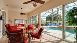 Covered lanai with patio table and swing seat - sliding doors so you can close off in bad weather from Monterey 3 Villa for rent in Orlando