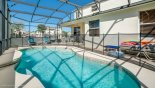 Spacious rental Highlands Reserve Villa in Orlando complete with stunning View of pool towards covered lanai