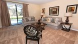 Family room with direct access to pool deck from Cypress Pointe rental Villa direct from owner