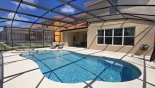 View of pool towards covered shady lanai with this Orlando Villa for rent direct from owner
