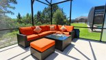 Luxury rattan sofa  & table - perfect for relaxing in the sun - www.iwantavilla.com is the best in Orlando vacation Villa rentals