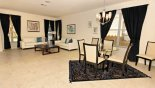 Living room & breakfast nook with this Orlando Villa for rent direct from owner
