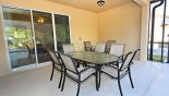 Villa rentals in Orlando, check out the Patio table under shady lanai with 6 - 8 chairs