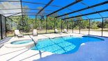 Sunny pool deck with 4 sun loungers & conservation views - www.iwantavilla.com is the best in Orlando vacation Villa rentals