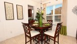Breakfast nook seating 4 adjacent to living room & kitchen from Belleair Beach 6 Villa for rent in Orlando
