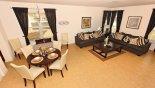 Living room & breakfast nook - www.iwantavilla.com is the best in Orlando vacation Villa rentals