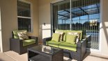 Lanai with rattan patio furniture from Crestview 4 Villa for rent in Orlando