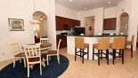 Crestview 5 Villa rental near Disney with Breakfast nook seating 4 adjacent to kitchen with breakfast bar & 4 bar stools