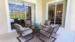 Villa rentals near Disney direct with owner, check out the Shady lanai with patio table & 4 comfortable  chairs