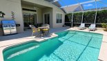 Pool with 2 sun loungers and stainless steek gas BBQ - www.iwantavilla.com is the best in Orlando vacation Villa rentals