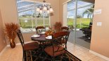 Dining area seating 4 with great views onto pool deck from Jasmine 7 Villa for rent in Orlando